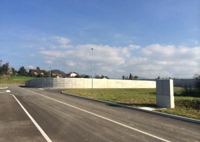 Asfaltiranje, javna razsvetljava in uporni AB zid